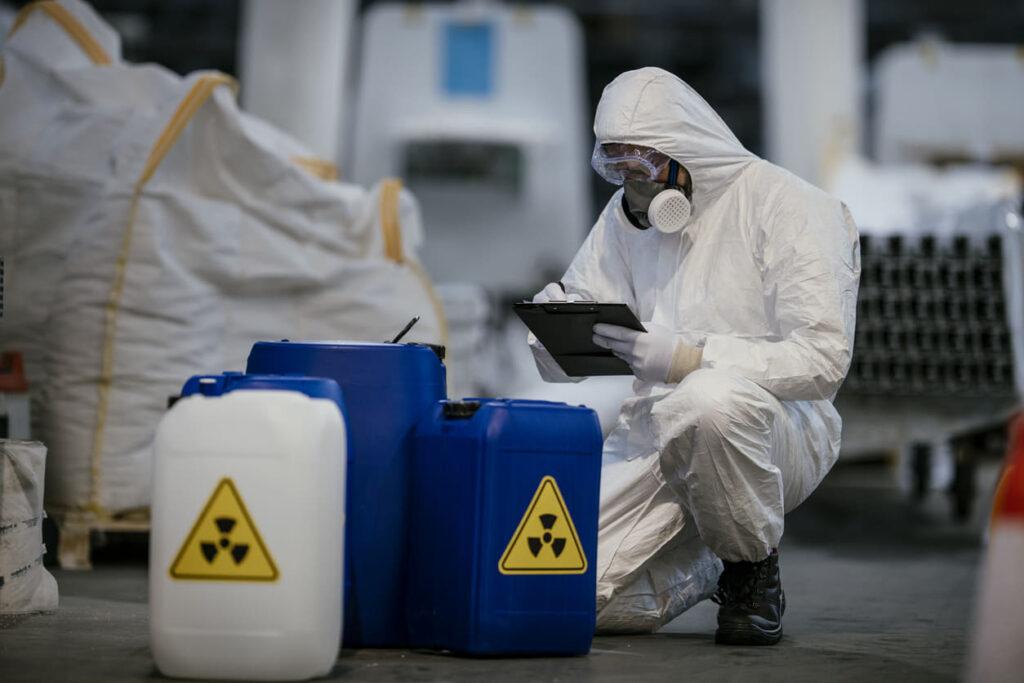 hazardous waste material worker in hazmat suit